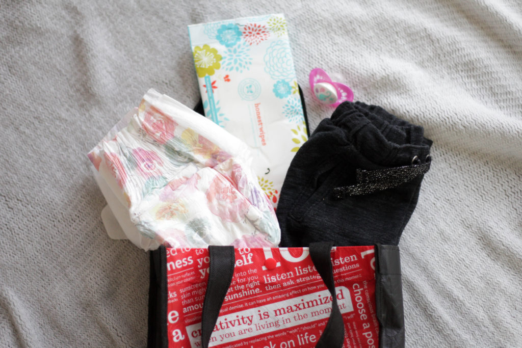 7 Essential Mom Hacks - Keep a bag of extras in your car for emergencies. #momhack #momlife