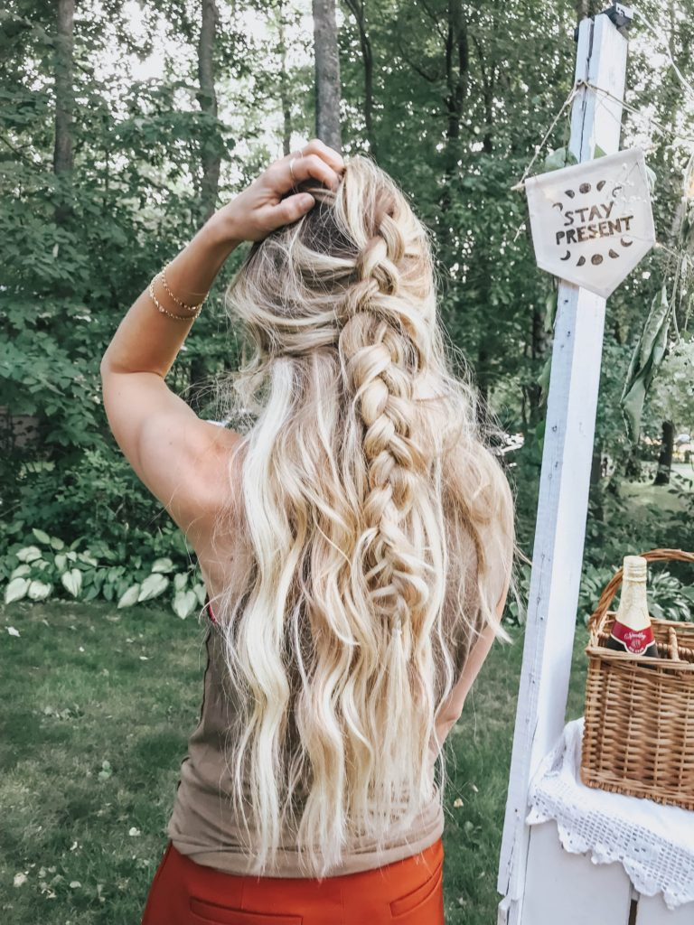 Barefoot blonde hair extensions in long half up braid.