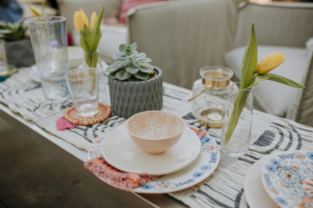 Outdoor tablescape with plants and flowers