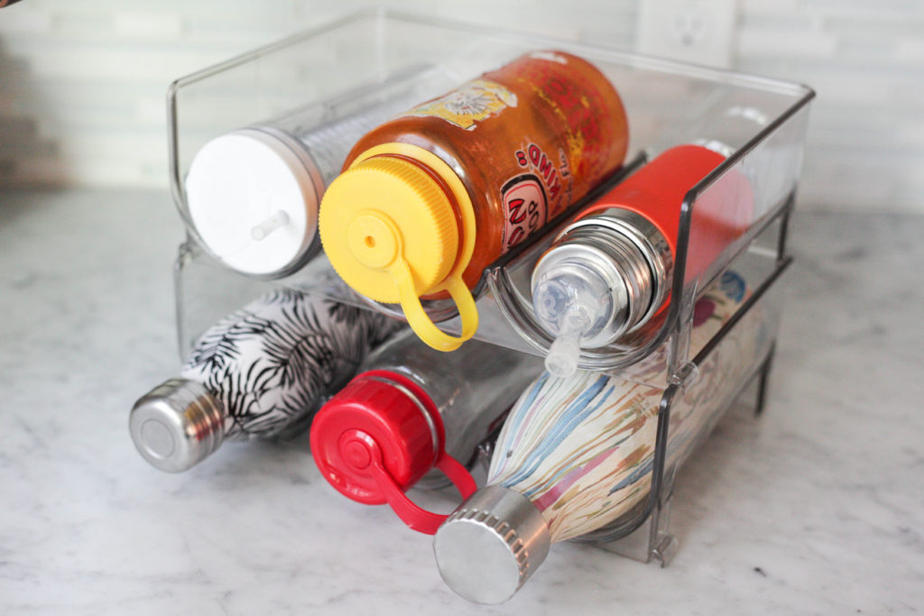 An easy home organization hack - stackable water bottle storage!