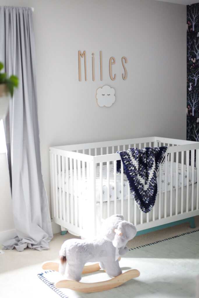 Simple baby boy nursery decor with Pottery Barn elephant rocker