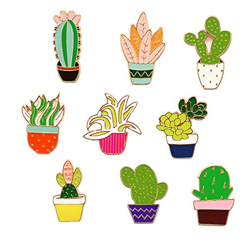 A collection of plant inspired enamel pins.