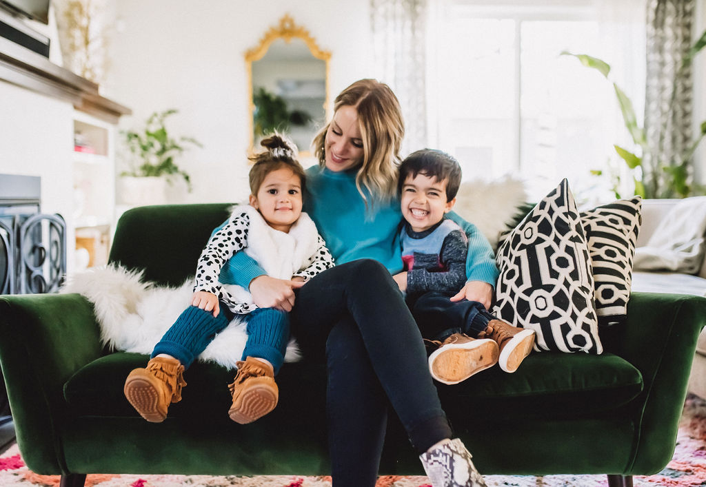 Mom + kids cozied up on couch wearing Hy-vee clothing