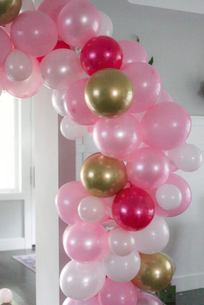 Pink, white and gold balloon garland for a Minnie Mouse birthday!