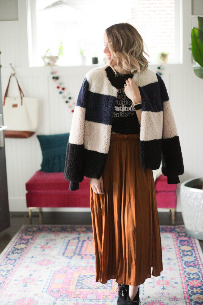 Midi skirt with graphic tee and striped jacket