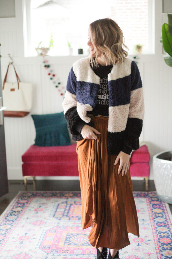 Midi skirt with graphic tee and striped sherpa jacket