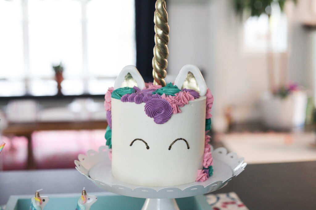 Pink, purple and teal unicorn birthday cake for a 1 year old birthday party