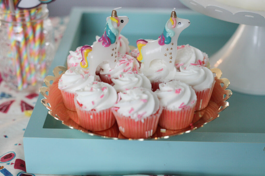 Simple funfetti cupcakes with unicorn candles for a 1 year old birthday party