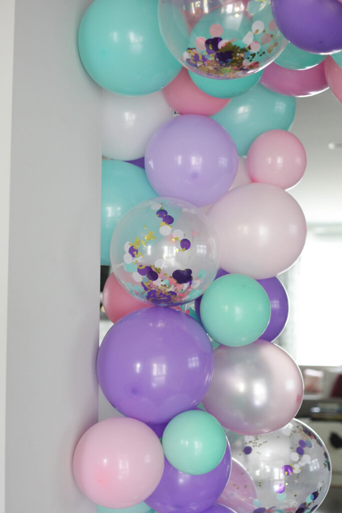 Confetti, pink, teal and purple balloon garland