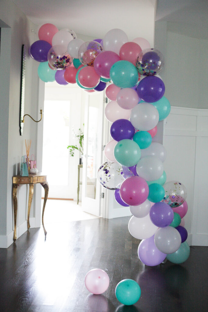 A multi color girly unicorn balloon arch