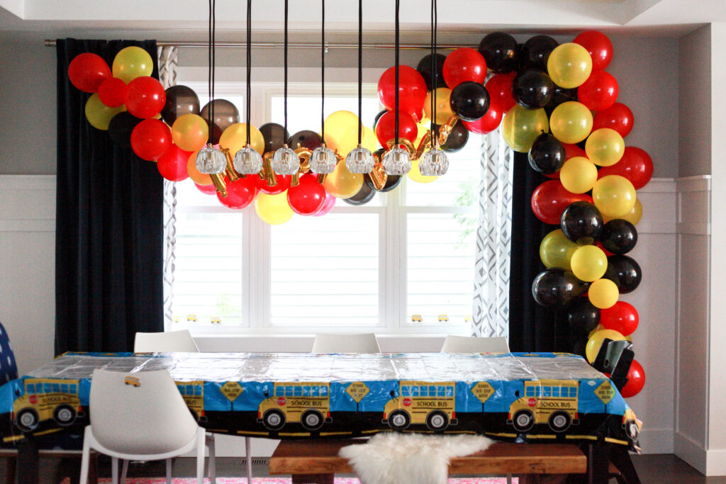 Red, black and yellow balloon arch for a Mickey Mouse birthday party for a 2 year old.