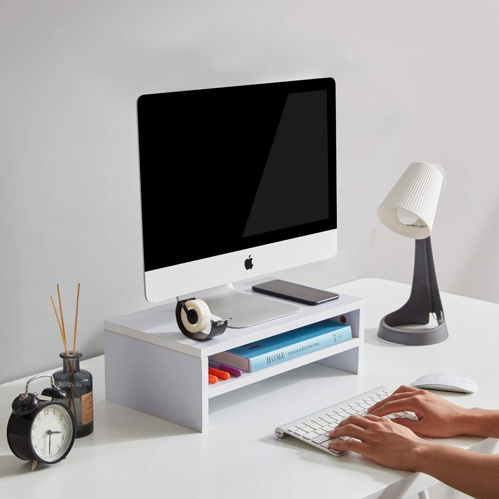 If you need to maximize your work space, get a stand for your computer! Easily store your planner, some small bins from #1 with your favorite pens, etc underneath.