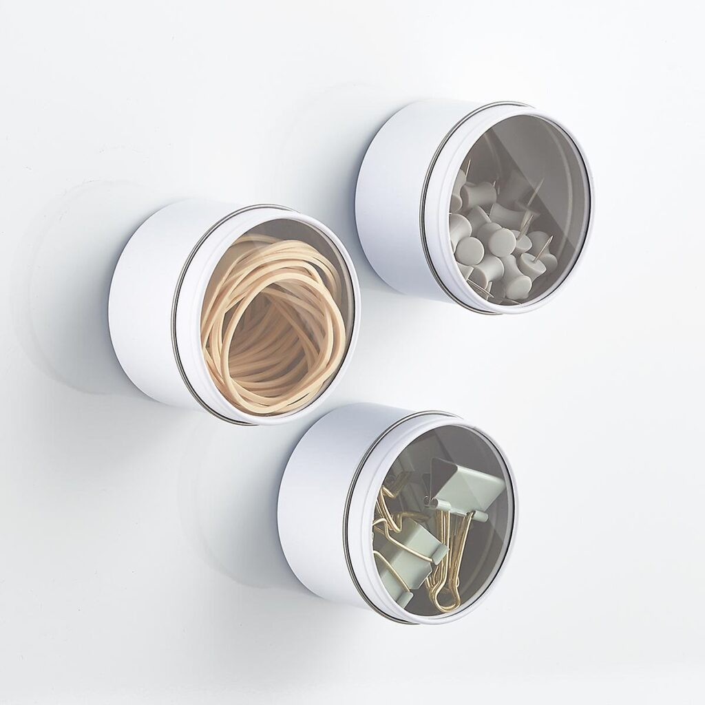 Round magnetic tins from the container stores for holding small items