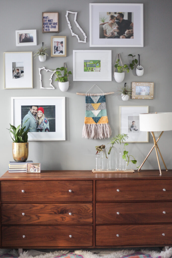 Gallery wall ideas - a collection of white, gold and plants