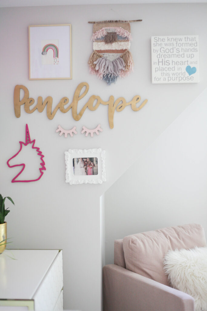 An eclectic gallery wall idea for a little girls room