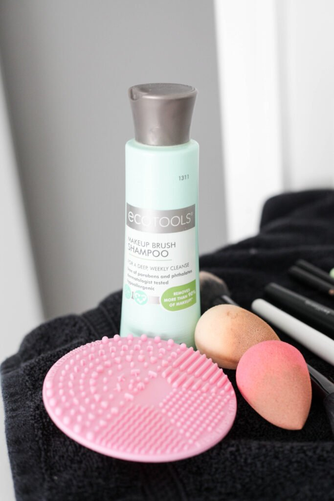 Ecotools and a cleaning pad to clean your brushes