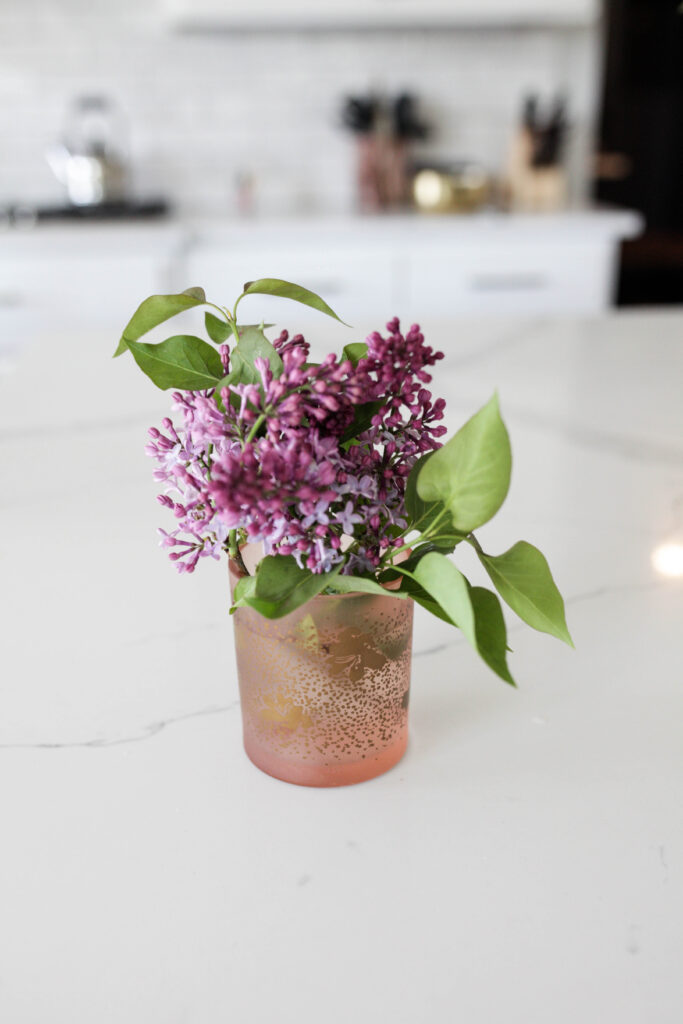 A candle jar used as a vase