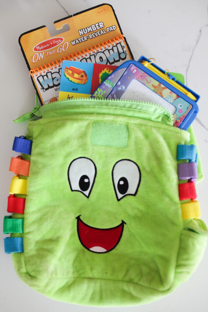 Keep a small bag of kid activities in your car.