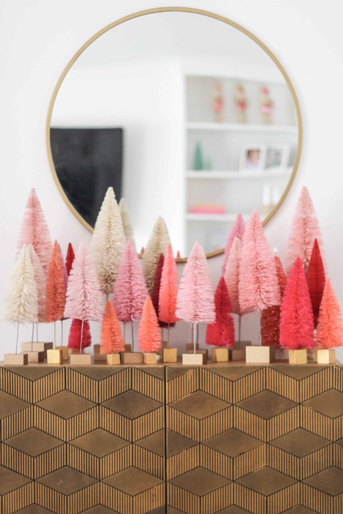 Paint your Bottle Brush Christmas Trees pink for a bright and cheerful tree scene!