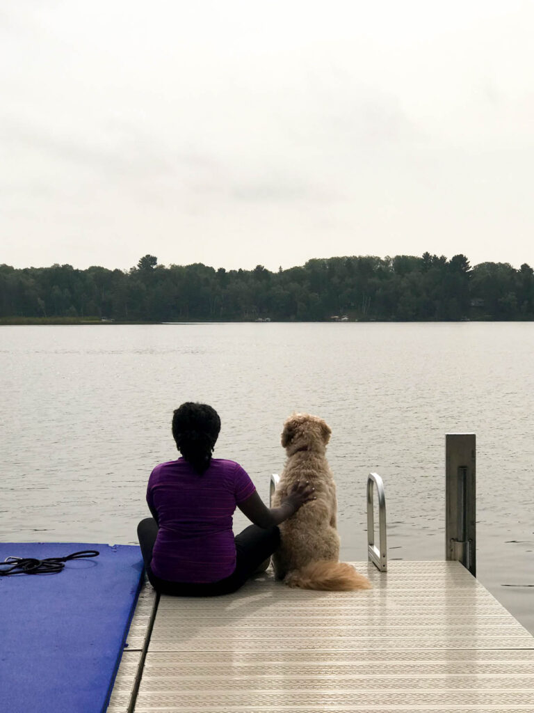 mini goldendoodle on lake