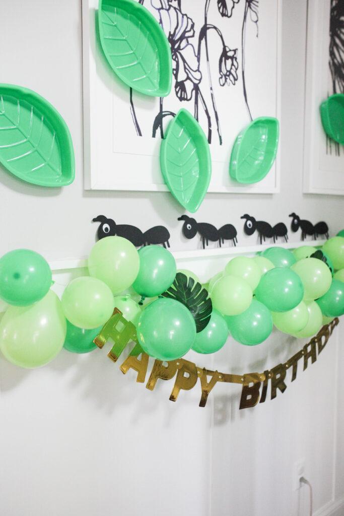 Bug decorations and balloon garland