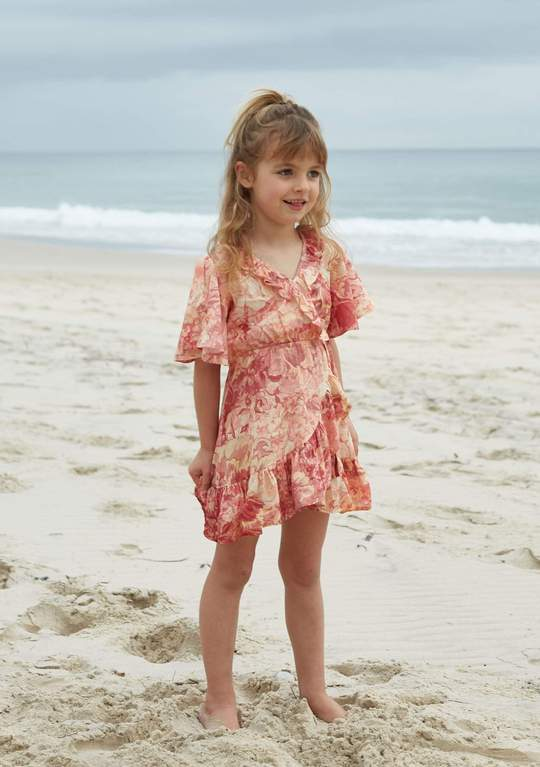 Little girl's pink ruffled dress from Auguste The Label