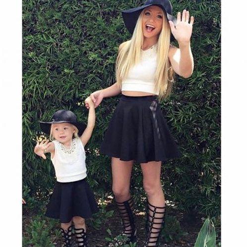 Mom and little girl in matching black skater skirts