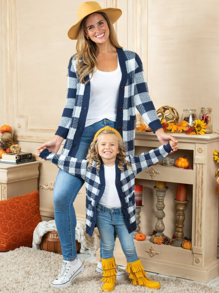 Mom and daughter in matching plaid cardigans