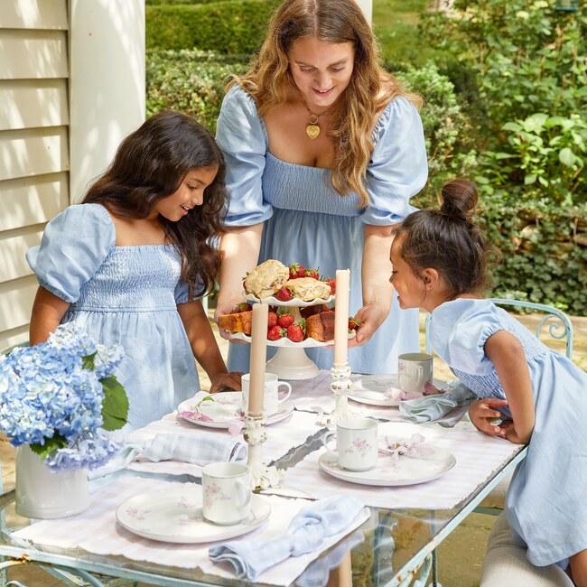 Mom matching daughters in Maisonette Celeste and Celine smocked dress
