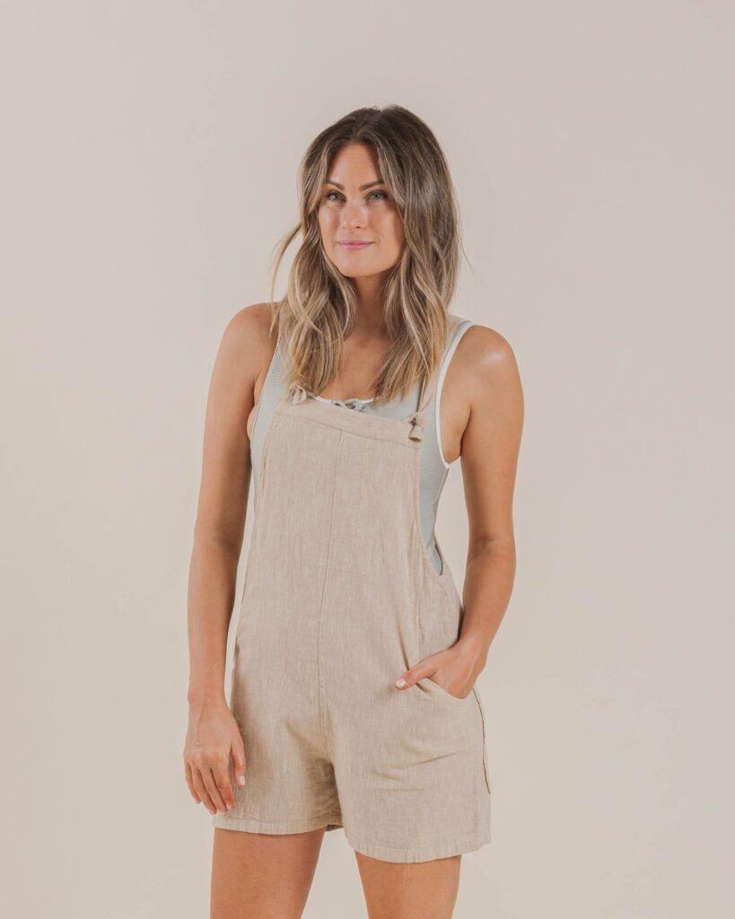 Woman in overalls from Rylee + Cru