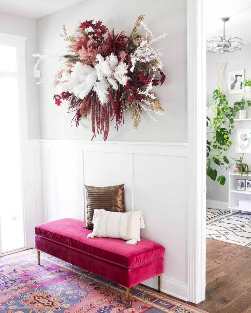 floral wall hanging in entrway